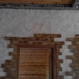 Отделка каменными панелями