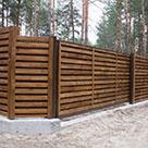 Дерев'яний паркан для дачі в сосновому бору