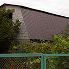 Завершение мансардной крыши дачного домика